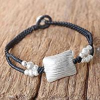 Silver pendant bracelet, 'Karen Pillow' - Karen 950 Silver Braided Pendant Bracelet from Thailand