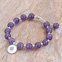 Amethyst beaded bracelet, 'Planetary Om' - Karen Silver and Amethyst Beaded Bracelet from Thailand