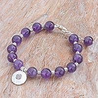 Amethyst beaded bracelet, 'Planetary Om' - Karen Silver and Amethyst Beaded Bracelet from Thailand