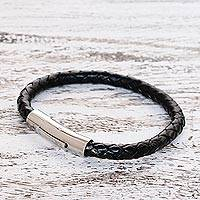 Leather wristband bracelet, 'Magical Braid in Black' - Black Braided Leather Wristband Bracelet from Thailand