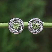 Peridot stud earrings, 'Cyclones' - Rhodium Plated Sterling Silver and Peridot Thai Earrings