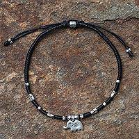 Silver accented cord bracelet, 'Elephant Luck' - Artisan Crafted Black Bracelet with Hill Tribe Silver Charm