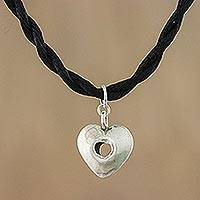 Silver pendant necklace, 'Hole in My Heart' - Karen Silver Heart Pendant Necklace from Thailand