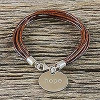 Silver and leather charm bracelet, 'Inspiring Earthen Reminder' - Thai Brown Leather Cord Bracelet with 950 Silver Hope Charm