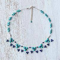 Calcite and lapis lazuli waterfall necklace, 'Chiang Mai Blossom' - Calcite and Lapis Lazuli Waterfall Necklace from Thailand