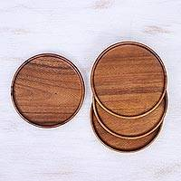 Wood plates, 'Natural Dark Discs' (set of 4) - Four Handcrafted Dark Raintree Wood Plates from Thailand