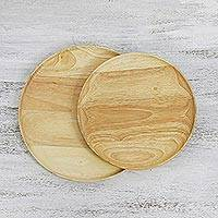 Wood plates, 'Natural Rounds' (pair) - Pair of Handcrafted Natural Wooden Plates from Thailand