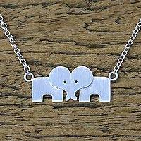 Sterling silver pendant necklace, 'Elephant Bond' - Sterling Silver Loving Elephant Necklace from Thailand