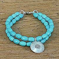 Beaded silver charm bracelet, 'Sky Blue Om Relaxation' - Calcite and Karen Silver Om Beaded Bracelet from Thailand