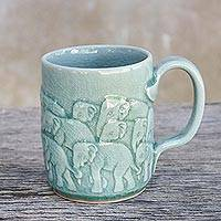 Celadon ceramic mug, 'Herd on Parade' - Elephant Themed Aqua Celadon Ceramic Mug