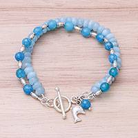 Quartz and aquamarine beaded bracelet, 'Blue Cutie' - Quartz and Aquamarine Dolphin Bracelet from Thailand