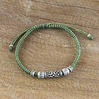 Silver beaded cord bracelet, 'Ancient Mood' - Thai Hand Crafted Silver Beaded Olive Green Cord Bracelet
