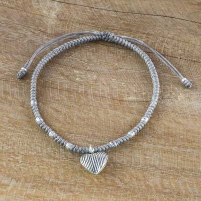 Silver charm cord bracelet, 'Ancient Heart in Grey' - Grey Cord Heart Charm Bracelet with Hill Tribe Silver