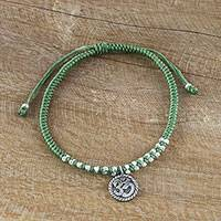 Silver charm bracelet, 'Ancient Om in Green' - Silver Om Charm Bracelet on Braided Green Cords