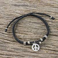 Silver beaded cord bracelet, 'Peace and Amity' - Ebony Colored Cord Beaded Bracelet with Silver Peace Charm