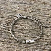 Silver accented cord bracelet, 'New Dawn' - Grey Cord Flower Motif Bracelet with Silver Peace Charm