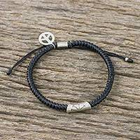 Silver accented cord bracelet,