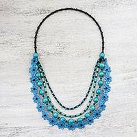 Wood beaded necklace, 'Flower Dream in Cyan' - Floral Wood Beaded Pendant Necklace in Cyan from Thailand