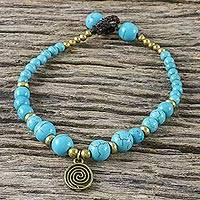 Brass beaded charm bracelet, 'Andaman Waves' - Turquoise Colored Bead Bracelet with Brass Charm