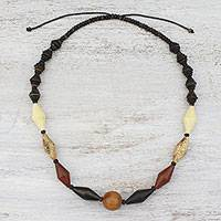Wood and coconut shell beaded necklace, 'Thai Traveler' - Wood and Coconut Shell Beaded Necklace from Thailand