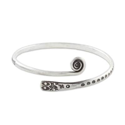 Sterling silver bangle bracelet, 'Silver Eye' - Handcrafted Sterling Silver Bangle Bracelet from Thailand