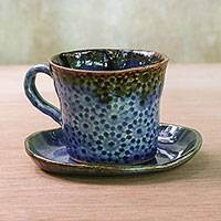 Ceramic cup and saucer, 'Lovely Fireworks in Blue' - Handcrafted Ceramic Cup and Saucer in Blue from Thailand