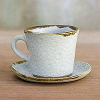 Ceramic cup and saucer, 'Lovely Fireworks in White' - Handcrafted Ceramic Cup and Saucer in White from Thailand