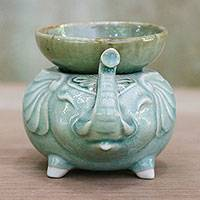 Celadon ceramic oil warmer, 'Elephant Fragrance in Green' - Elephant-Shaped Celadon Ceramic Oil Warmer from Thailand