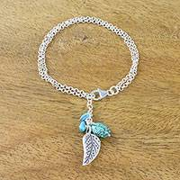 Silver charm bracelet, 'Lively Leaf' - Silver and Recon Turquoise Leaf Bracelet from Thailand