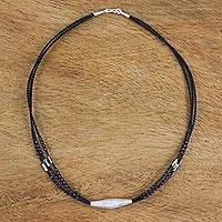 Silver and garnet pendant necklace, 'Lampang Treasure' - Three Strand Cord Necklace with Garnet and 950 Silver
