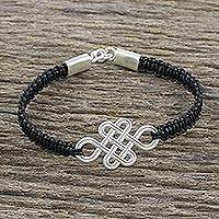 Sterling silver and leather pendant bracelet, 'Fortune's Knot in Black' - Brushed Silver Knot Pendant Bracelet from Thailand