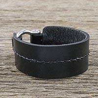 Leather wristband bracelet, 'Tenacious Spirit' - Hand Crafted Black Leather Wristband Bracelet from Thailand