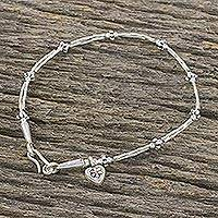 Silver and sterling silver charm bracelet, 'Cluster of Charm' - Karen Silver and Sterling Silver Heart Shaped Charm Bracelet
