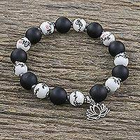 Onyx and ceramic beaded stretch charm bracelet, 'Night Lotus' - Beaded Ceramic and Onyx Stretch Bracelet with Lotus Charm