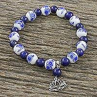Lapis lazuli and ceramic beaded charm bracelet, 'Ming Lotus' - Blue and White Beaded Stretch Bracelet from Thailand