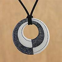 Ceramic pendant necklace, 'Infinite Duality' - Ceramic Thai Handmade Black and White Pendant Necklace