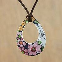 Ceramic pendant necklace, 'Bursting Blooms' - Ceramic Floral Pendant Necklace on a Faux Suede Cord