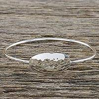 Sterling silver bangle bracelet, 'Silver Moonrise in Texture' - Sterling Silver Bangle Bracelet with Hammered Oval Pendant