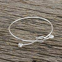 Sterling silver bangle pendant bracelet, 'Tie the Knot' - Sterling Silver Wire Bangle Bracelet with Knot Pendant