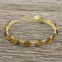 Gold plated tiger's eye bangle bracelet, 'Romantic Fling' - 18k Gold Plated Tiger's Eye Bangle Bracelet from Thailand