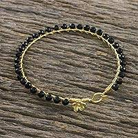 Gold plated onyx bangle bracelet, 'Fall in Love' - Gold Plated Black Onyx Bangle Bracelet from Thailand