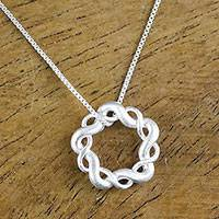 Sterling silver pendant necklace, 'Infinity Twine' - Sterling Silver Pendant Necklace Handmade in Thailand