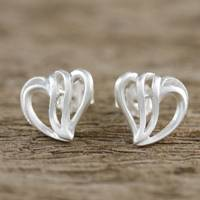 Sterling silver stud earrings, 'Comforting Hearts' - Sterling Silver Heart-Shaped Stud Earrings from Thailand