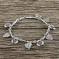 Silver charm bracelet, 'Rose Bush' - Karen Silver Charm Bracelet with Rose and Leaf Motifs