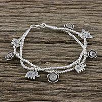 Silver beaded charm bracelet, 'Elephant Flowers' - Karen Silver Floral Elephant Charm Bracelet from Thailand