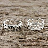 Sterling silver ear cuffs, 'Dizzying Beauty' - Floral and Wave Motif Sterling Silver Ear Cuffs