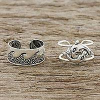 Sterling silver ear cuffs, 'Dolphins in the Ocean' - Dolphin and Wave Motif Sterling Silver Ear Cuffs