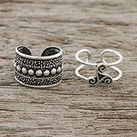 Sterling silver ear cuffs, 'Unique Beauty' - Spiral and Circle Motif Sterling Silver Ear Cuffs