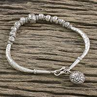 Silver beaded bracelet, 'Lotus Hill Tribe' - Floral Karen Silver Beaded Bracelet from Thailand