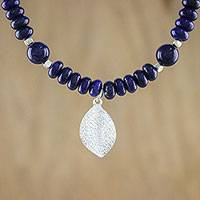 Lapis lazuli beaded pendant necklace, 'Sophisticated Leaf' - Lapis Lazuli Beaded Necklace with Karen Silver Leaf Pendant